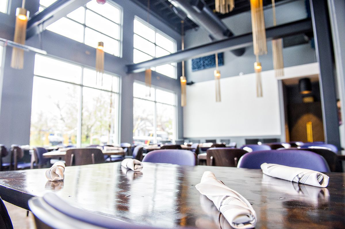 The main dining area at Pistol Whip features tassled chandeliers hanging throughout.