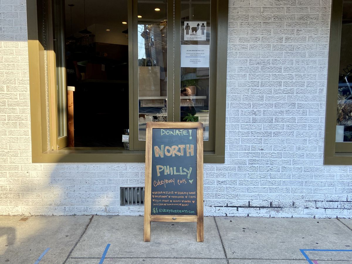 takeout window and sign that says donate north philly everybody eats