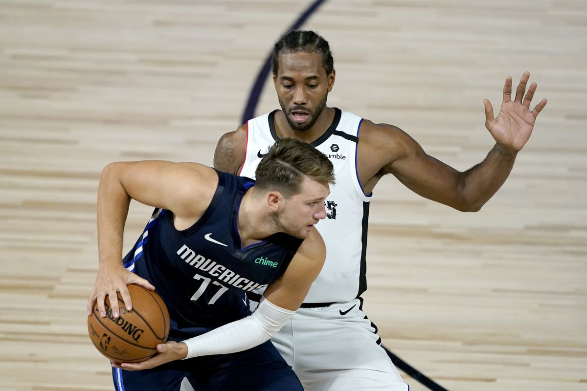 Kawhi Leonard of the Los Angeles Clippers applies pressure on Luka Doncic  of the Dallas Mavericks during the second half of an NBA basketball game at the ESPN Wide World Of Sports Complex on August 6, 2020 in Lake Buena Vista, Florida.