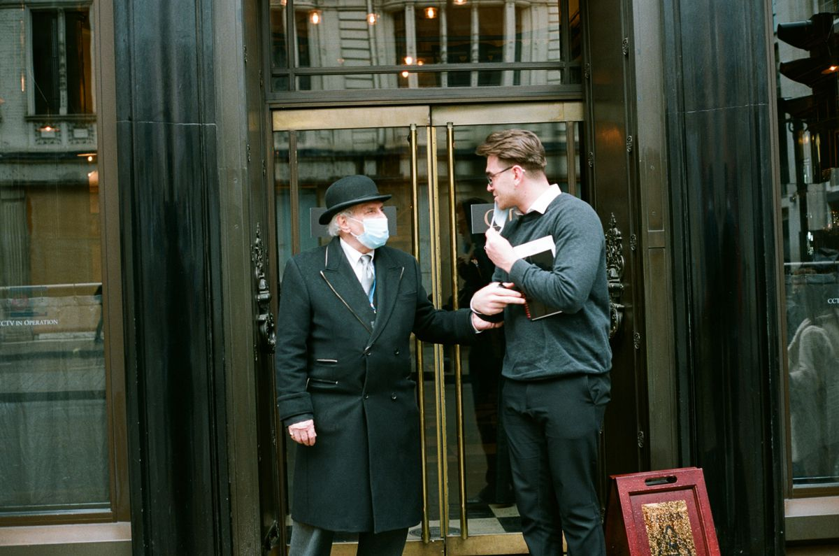 The Wolseley's doorman says goodbye to a customer leaving the restaurant