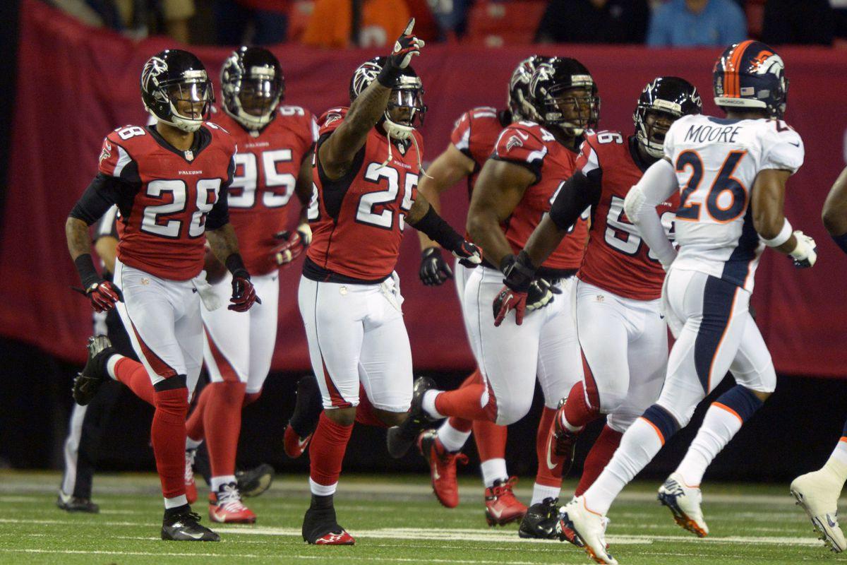 Sep 17, 2012; Atlanta, GA, USA; Atlanta Falcons safety William Moore (25) celebrates after an interception in the first quarter against the Denver Broncos at the Georgia Dome. Mandatory Credit: Kirby Lee/Image of Sport-US PRESSWIRE