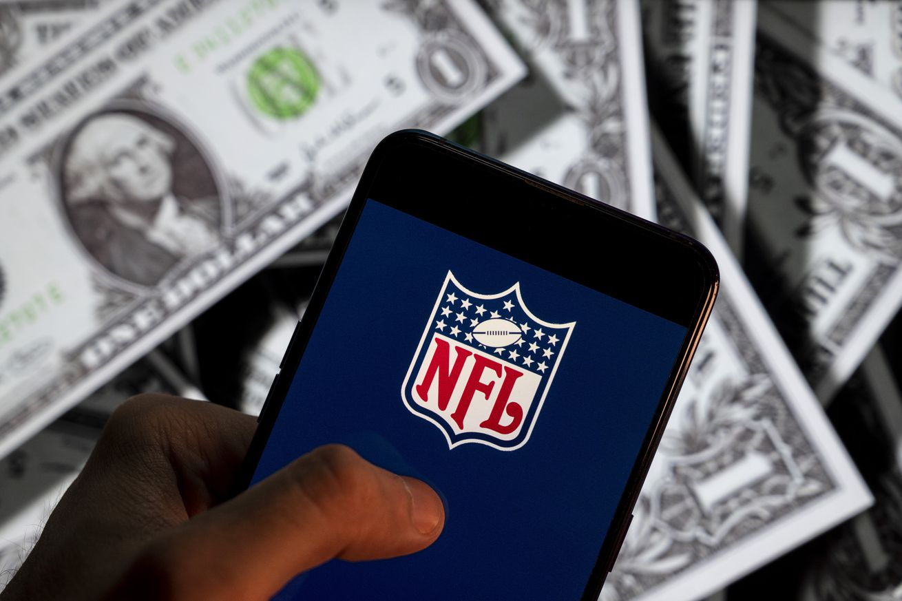 In this photo illustration the American football league, The...