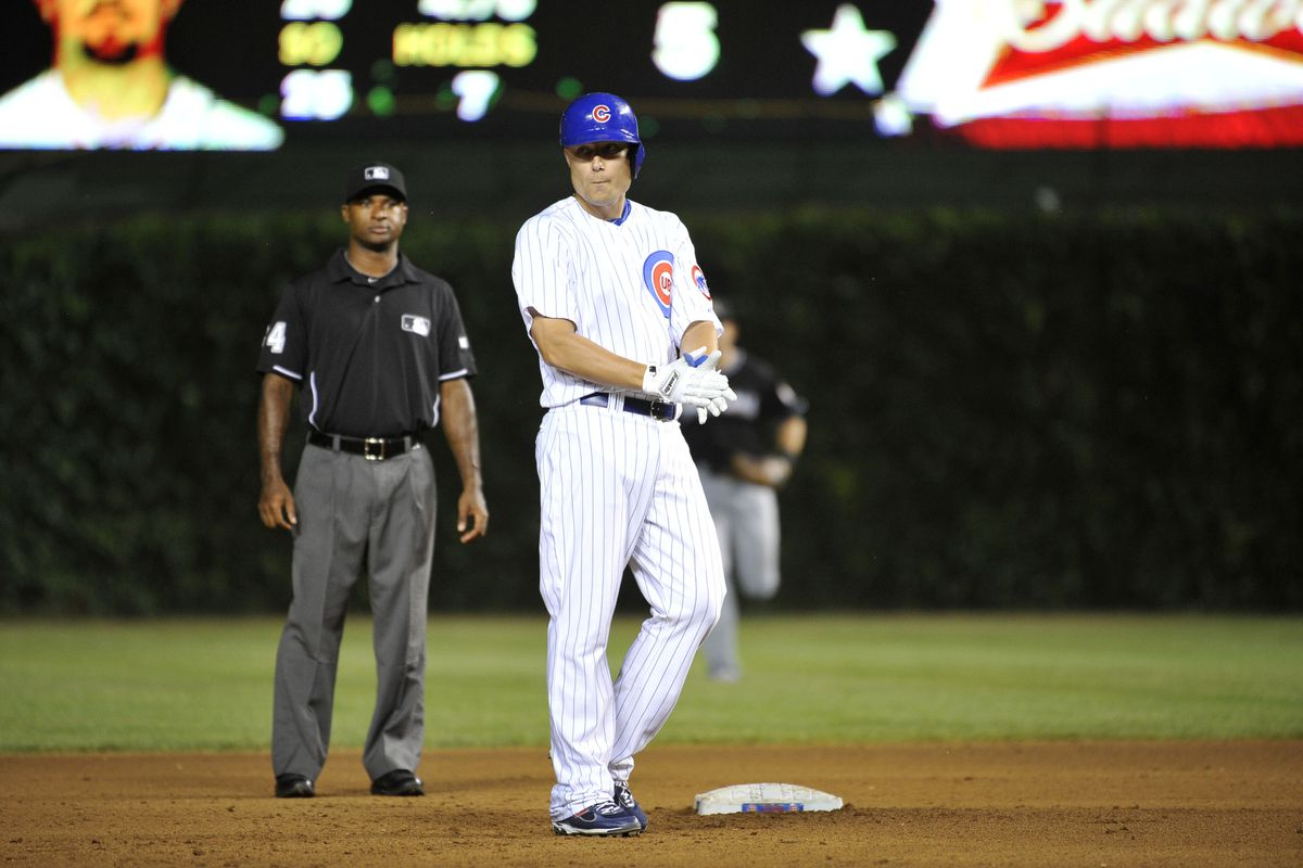 Jeff Baker of the Chicago Cubs claps as he stands on second base after hitting an RBI double scoring teammates Geovany Soto and Darwin Barney against the Miami Marlins at Wrigley Field in Chicago, Illinois.  (Photo by Brian Kersey/Getty Images)