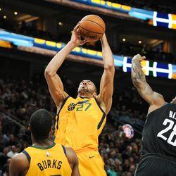 Utah Jazz center Rudy Gobert (27) pulls down a rebound in front of Houston Rockets forward Tarik Black (28) as the Utah Jazz host the Houston Rockets at Vivint Smart Home Arena Salt Lake on Thursday, Dec. 7, 2017.