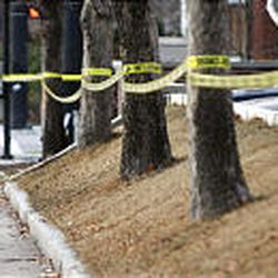 A security guard walks the cordoned off grounds of Trolley Square in Salt Lake City Tuesday, a day after a gunman entered the mall on a shooting rampage.