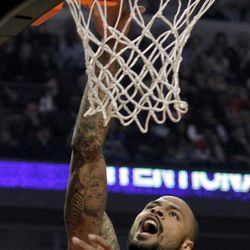 New York Knicks' Tyson Chandler lays up a shot against the Chicago Bulls during the first half of an NBA basketball game Tuesday, April 10, 2012, in Chicago.