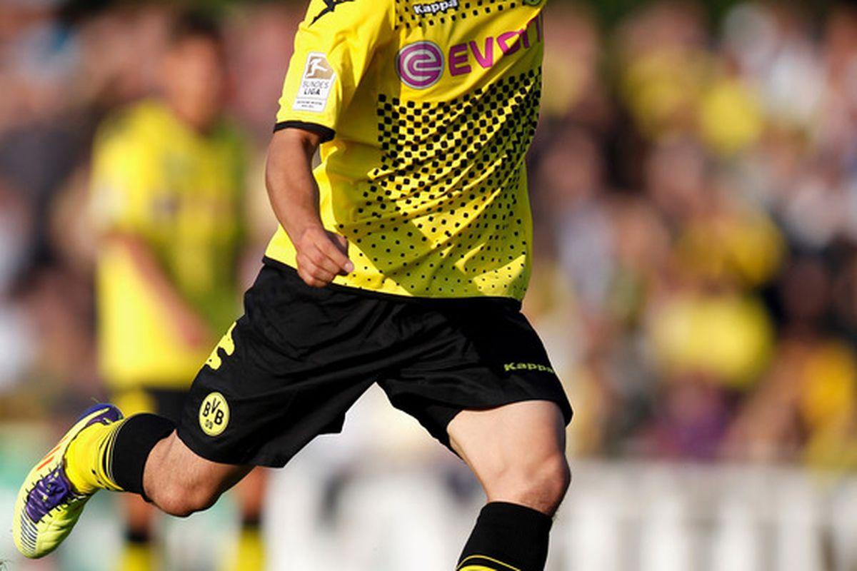 ARNSBERG, GERMANY - JULY 04:  Shinji Kagawa of Dortmund runs with the ball during pre-season friendly match between Team Sauerland and Borussia Dortmund on July 4, 2011 in Arnsberg, Germany.  (Photo by Friedemann Vogel/Bongarts/Getty Images)