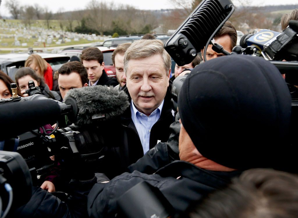 Republican Rick Saccone, center, is surrounded by cameras and reporters as he heads to the polling place to cast his ballot, Tuesday, March 13, 2018, in McKeesport, Pennsylvania. | Keith Srakocic/AP Photo