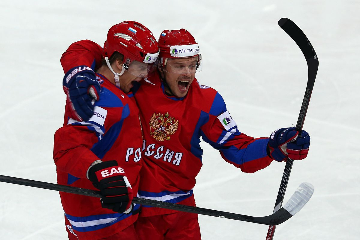 If you're not sure, Belov is the guy on the left.