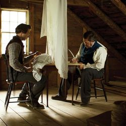 """Joseph Smith, played by Dustin Harding, translates the Book of Mormon in """"Joseph Smith, Volume 1: Plates of Gold."""""""