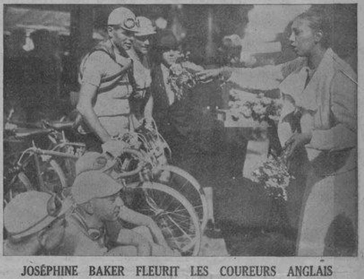 Josephine Baker offers her flowers to the Tour's first British entrants, Bill Burl and Charles Holland.