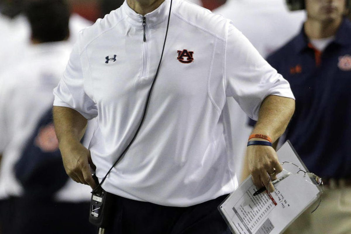 Auburn Coach Gene Chizik reacts after a Clemson score in the second quarter of a NCAA college football game at the Georgia Dome in Atlanta Saturday, Sept. 1, 2012.