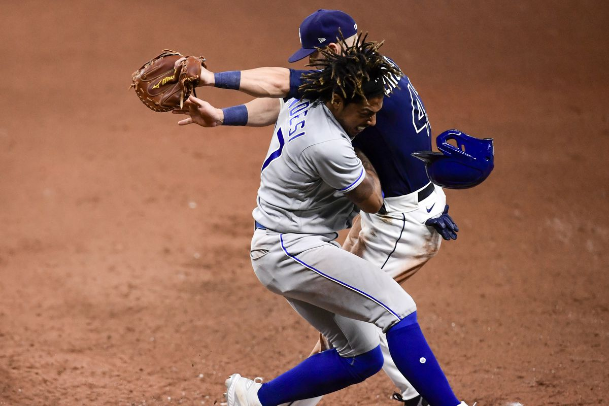 Adalberto Mondesti #27 of the Kansas City Royals collides with Mike Brosseau #43 of the Tampa Bay Rays on first base after being thrown out during the tenth inning at Tropicana Field on May 26, 2021 in St Petersburg, Florida.