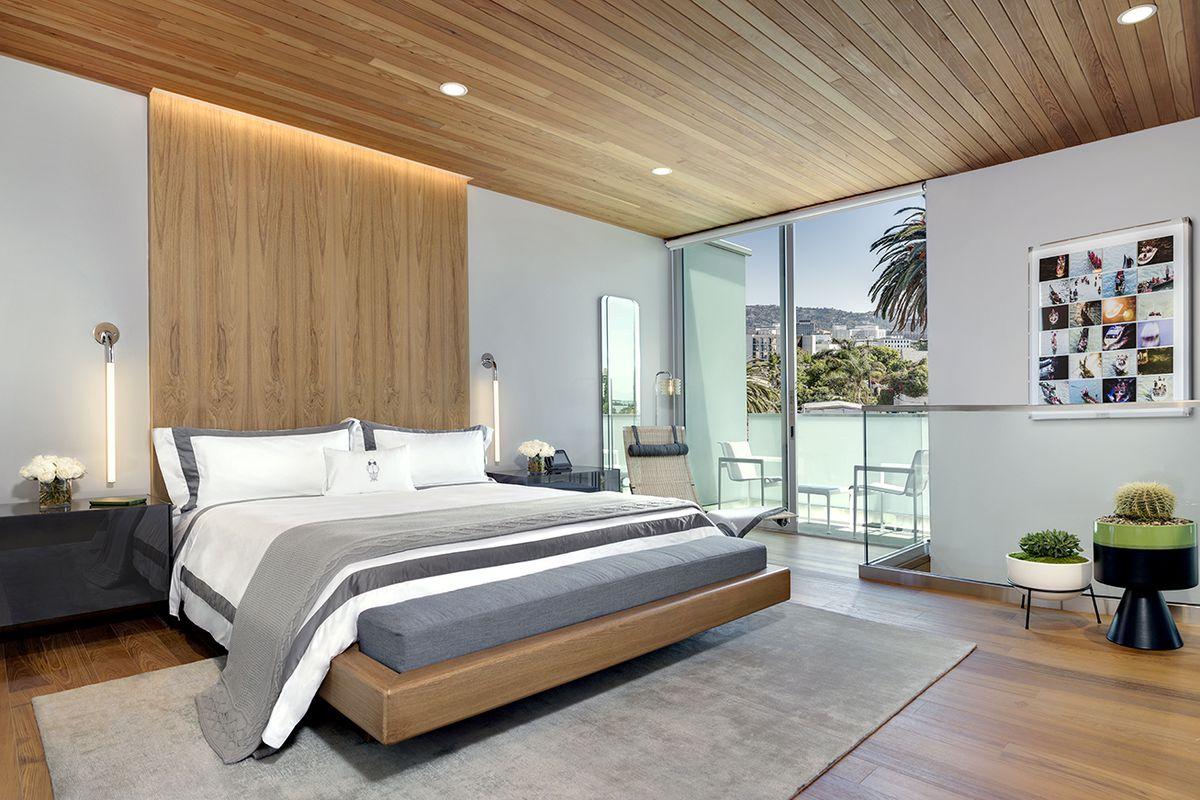 Bedroom with wide windows and hardwood floors