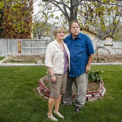 Donna Norman and James Norman Sr. pose for a portrait in the backyard of their house in Orem on Tuesday, April 11, 2017. The couple's son, James Norman Jr., is accused of strangling his roommate while he was a patient at the Utah State Hospital. Due to competency questions he has been waiting six years to stand trial.