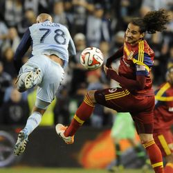 Real Salt Lake's Devon Sandoval heads the ball past Sporting KC's Aurelien Collin during a game at Sporting Park in Kansas City, Kan., on Saturday, April 5, 2014.