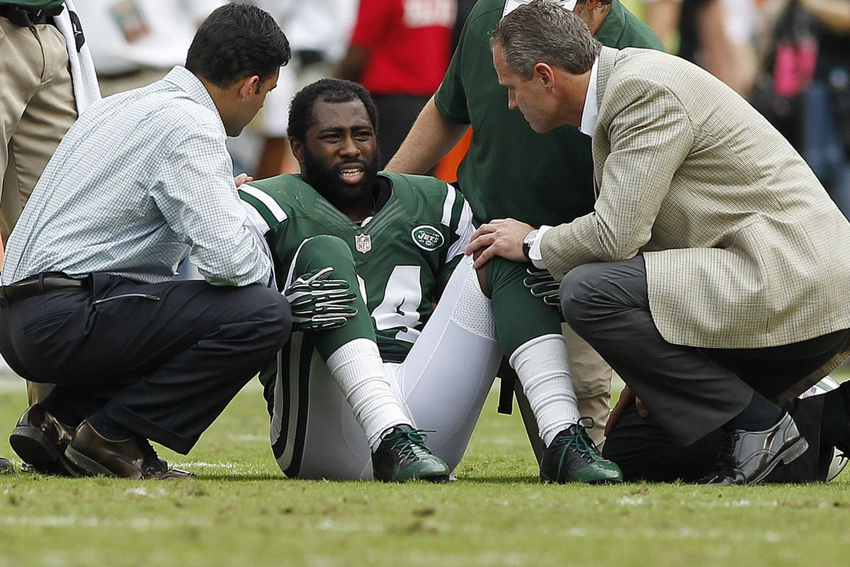 New York Jets cornerback Darrelle Revis (24) is attended to after being injured in the second half in a game against the Miami Dolphins at Sun Life Stadium. Revis will miss the remainder of the season with a torn ACL. Robert Mayer-US PRESSWIRE