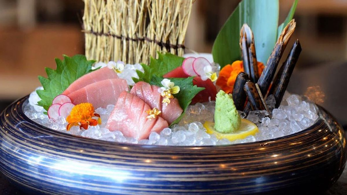 bluefin tuna sashimi on a platter with garnishes