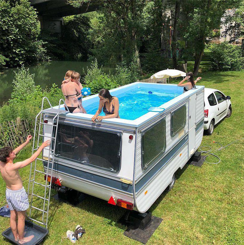 People swimming in small pool