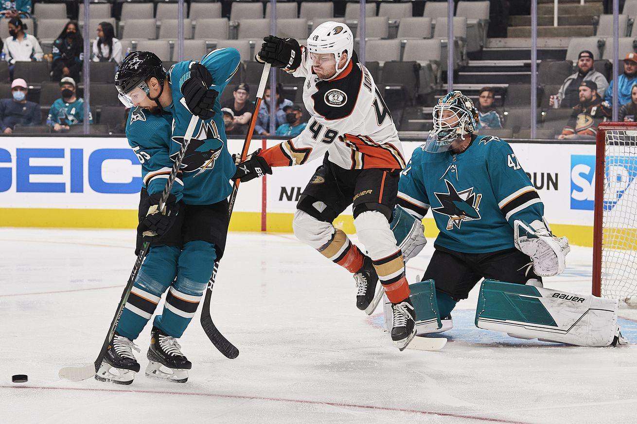 San Jose Sharks defenseman Erik Karlsson (65) redirects a shot in front of Anaheim Ducks left wing Max Jones (49) during the game on October 4, 2021, at SAP Center at San Jose in San Jose, CA