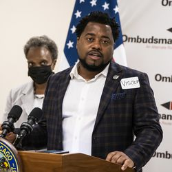 Mayor Lori Lightfoot looks on as Chicago Public Schools Interim Chief Education Officer Maurice Swinney speaks during a news conference at Ombudsman Chicago South Alternative School.