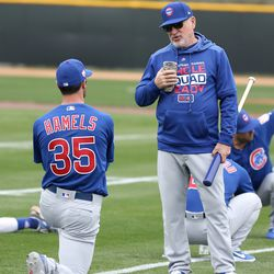 Joe Maddon talks with Cole Hamels during stretching at the Under Armour Performance Center, the Spring Training home of the Chicago Cubs in Mesa, AZ.  | John Antonoff/For the Sun-Times