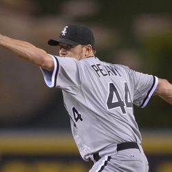 Chicago White Sox starting pitcher Jake Peavy throws to the plate during the second inning of their baseball game against the Los Angeles Angels, Friday, Sept. 21, 2012, in Anaheim, Calif. AP Photo/Mark J. Terrill)