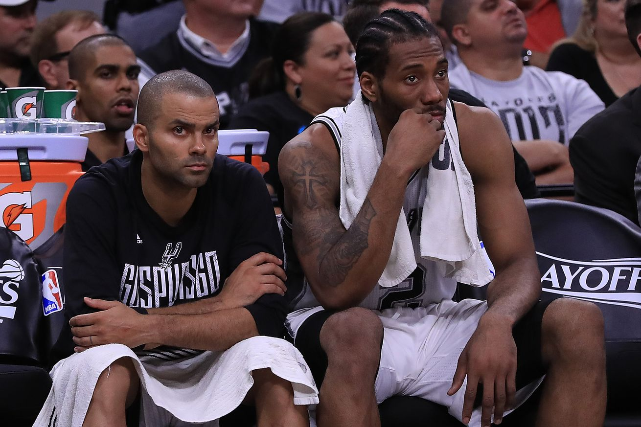 SAN ANTONIO, TX - MAY 01: (L-R) Tony Parker #9 and Kawhi Leonard #2 of the San Antonio Spurs sit on the bench in the fourth quarter during Game One of the NBA Western Conference Semi-Finals against the Houston Rockets at AT&T Center on May 1, 2017 in San Antonio, Texas. NOTE TO USER: User expressly acknowledges and agrees that, by downloading and or using this photograph, User is consenting to the terms and conditions of the Getty Images License Agreement. (Photo by Ronald Martinez/Getty Images)
