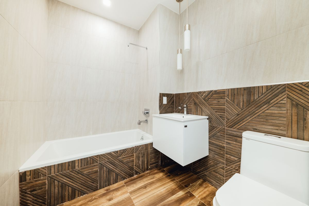 A bathroom with beige and brown walls.