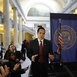 Sean Reyes talks to the media after taking the oath of office as Utah's attorney general in the rotunda of the state Capitol in Salt Lake City on Monday, Dec. 30, 2013. Reyes replaces John Swallow, who resigned in November.