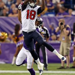 Aug 9, 2013; Minneapolis, MN, USA; Houston Texans wide receiver Lestar Jean (18) jumps up and catches a pass over Minnesota Vikings defensive back Brandon Burton (27) in the first quarter at the Metrodome.
