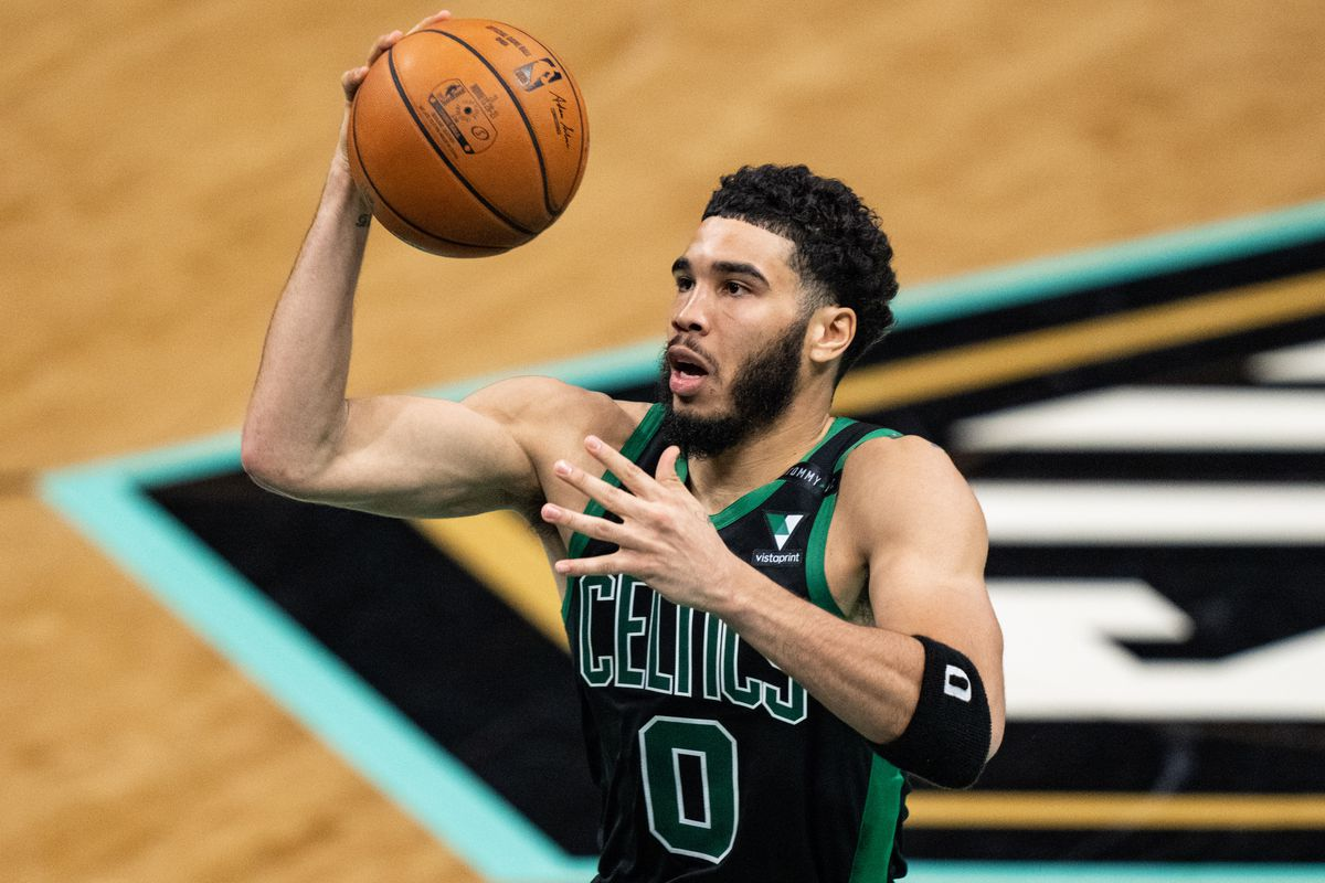 Jayson Tatum of the Boston Celtics drives to the basket against the Charlotte Hornets in the third quarter during their game at Spectrum Center on April 25, 2021 in Charlotte, North Carolina.