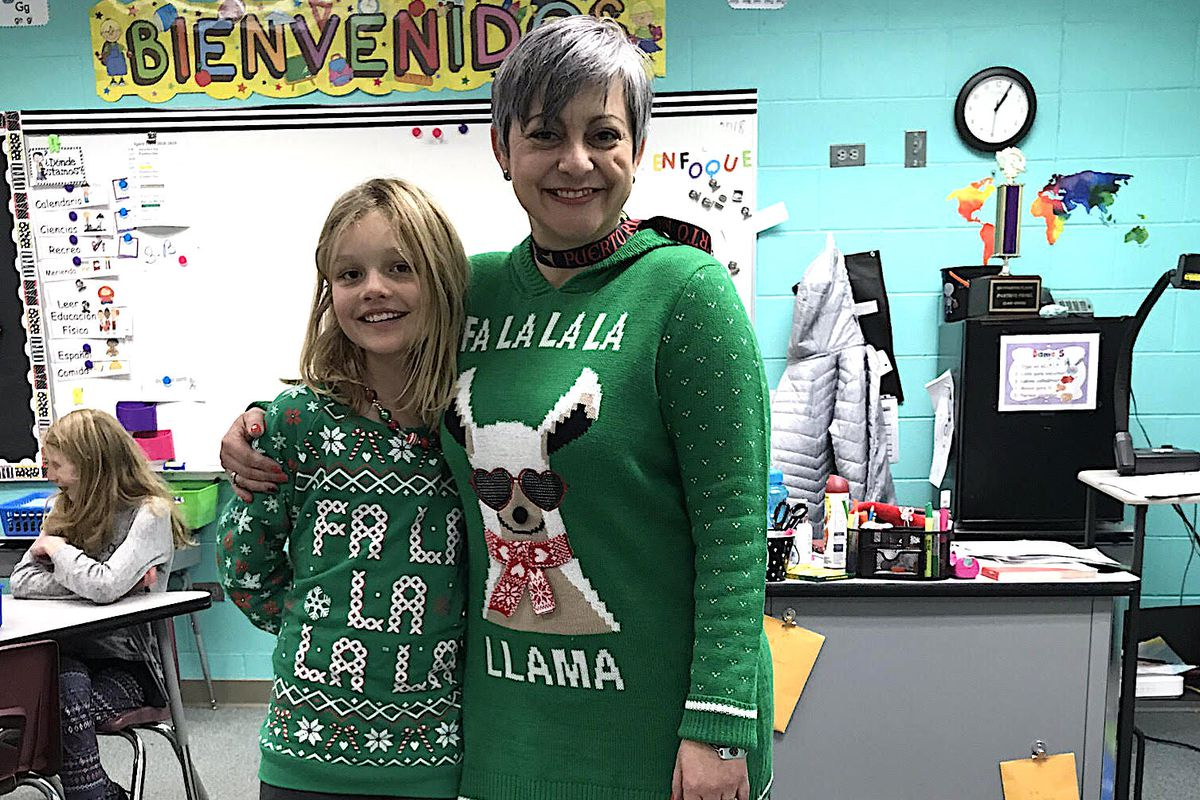 Yesenia Perez-Mercado, a third-grade teacher at Cottonwood Plains Elementary Schools, stands with a student.