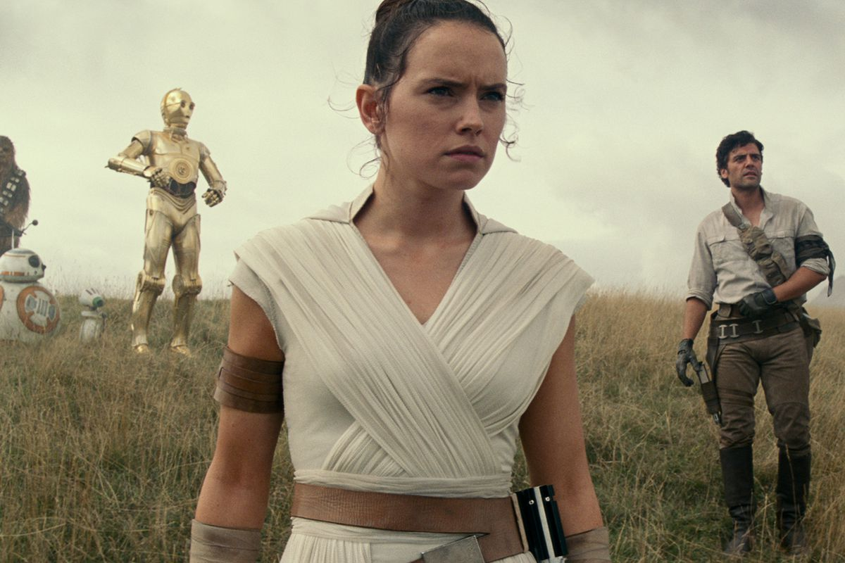 Rey (Ridley), Poe Dameron (Oscar Isaac), and Finn (John Boyega) survey the land.