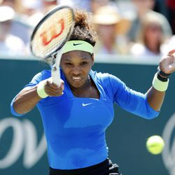 Serena Williams returns a shot to Samantha Stosur, of Australia, during their semifinals match at the Family Circle Cup tennis tournament in Charleston, S.C., Saturday, April 7, 2012.  Williams advanced to the finals by winning 6-1, 6-1.