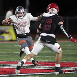 Skyridge's  McCae Hillstead runs with the ball around American Fork's Jeter Fenton during a varsity football game at American Fork High School in American Fork on Wednesday, Oct. 13, 2021. Skyridge won 42-22.
