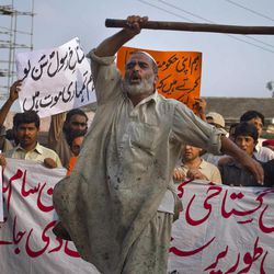 """A Pakistani worker shouts anti U.S. slogans during a rally in Islamabad, Pakistan on Saturday, Sept. 15, 2012 as part of widespread anger across the Muslim world about a film ridiculing Islam's Prophet Muhammad. The banner at bottom reads, """"'immediately hang the cursed man indulged in insulting the Prophet,"""" while the banner at top left reads, """"Oh blasphemer! Listen we are after your life,"""" and the banner at top, second left reads,""""we urge the government to stop U.S. interference in the Pakistan."""""""