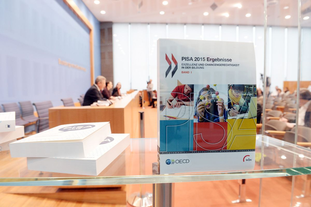 The OECD presented PISA results from 2015 at a press conference in Berlin, Germany, 6 December 2016. (Photo by Maurizio Gambarini/picture alliance via Getty Images)