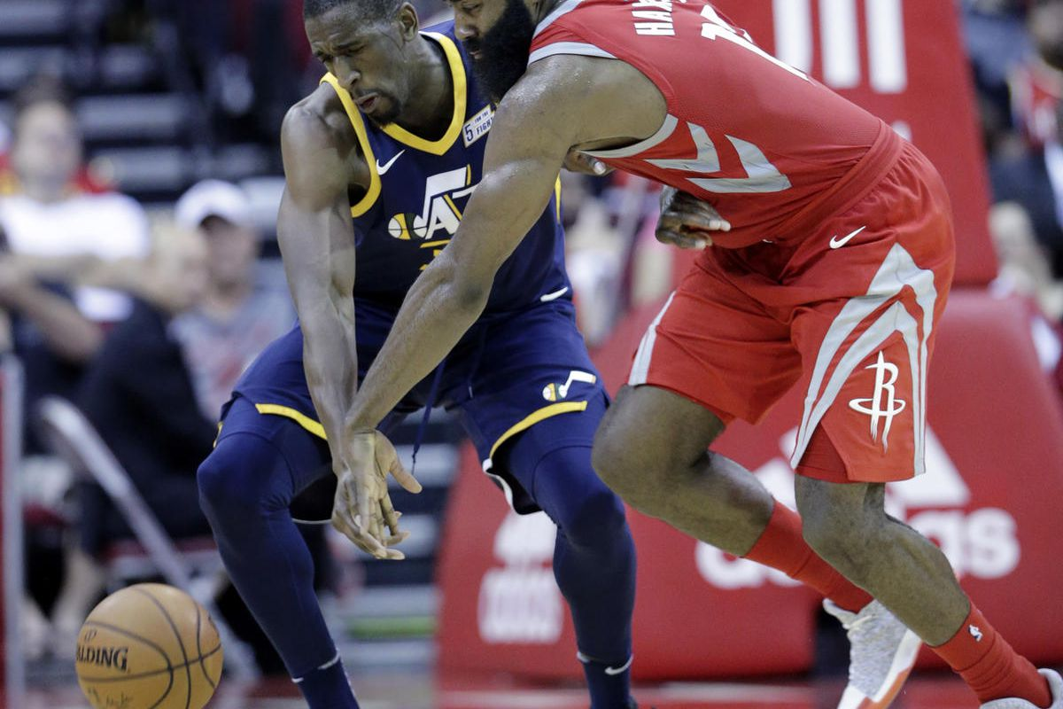 Utah Jazz center Ekpe Udoh (33) and Houston Rockets guard James Harden (13) scramble for a loose ball in the second half of an NBA basketball game, Sunday, Nov. 5, 2017, in Houston. (AP Photo/Michael Wyke)