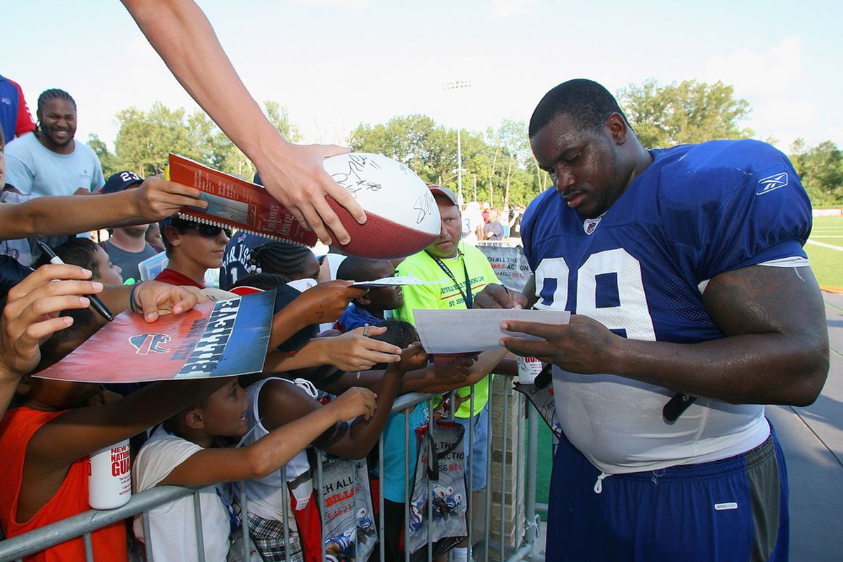 PITTSFORD, NY - AUGUST 08: Marcell Dareus #99 of the Buffalo Bills signs autographs during the Buffalo Bills Training Camp at St. John Fisher College on August 8, 2011 in Pittsford, New York.  (Photo by Rick Stewart/Getty Images)