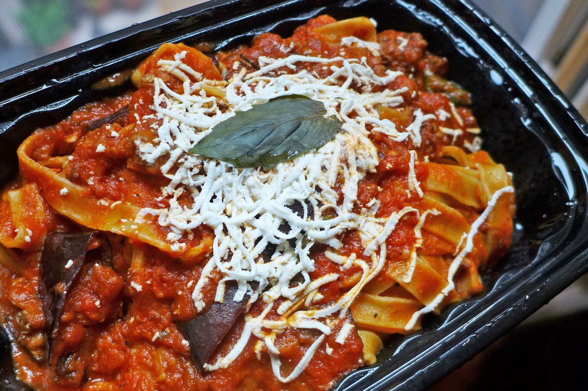 Broad noodles with tomato sauce and grated cheese.