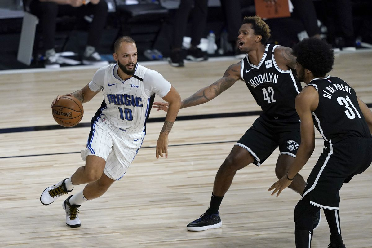 Evan Fournier of the Orlando Magic heads to the basket as Lance Thomas and Jarrett Allen of the Brooklyn Nets defend during the first half on July 31, 2020 at The HP Field House at ESPN Wide World Of Sports Complex in Lake Buena Vista, Florida.