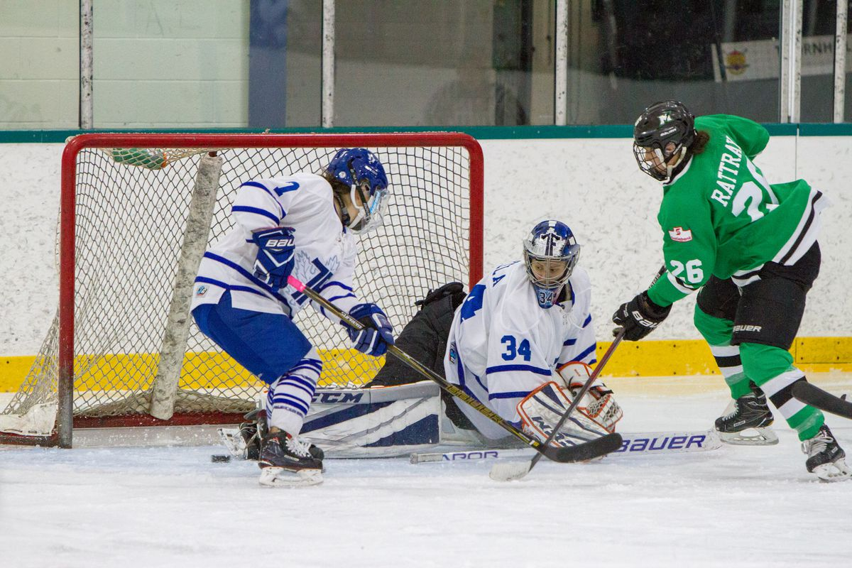 Jamie Lee Rattray (26) of the Markham Thunder gets a chance on Amanda Makela (34) of the Toronto Furies in their February 4th game.