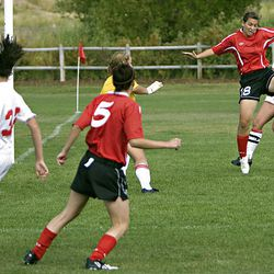 Bountiful's Katerina Skedros, right, one-touches a cross to the middle for a goal against Park City as Park City hosts Bountiful in preseason high school soccer on Tuesday. Bountiful won 6-0.