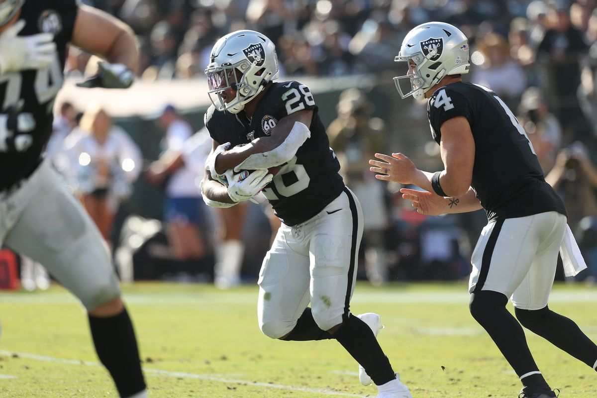 Oakland Raiders running back Josh Jacobs runs the ball against the Detroit Lions in the second quarter at Oakland Coliseum.