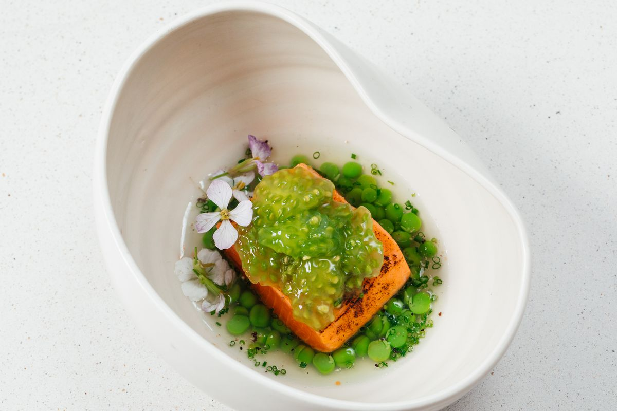 """Salmon, spring peas stewed in """"ranch"""" whey, green tomato packets, bitter greens"""
