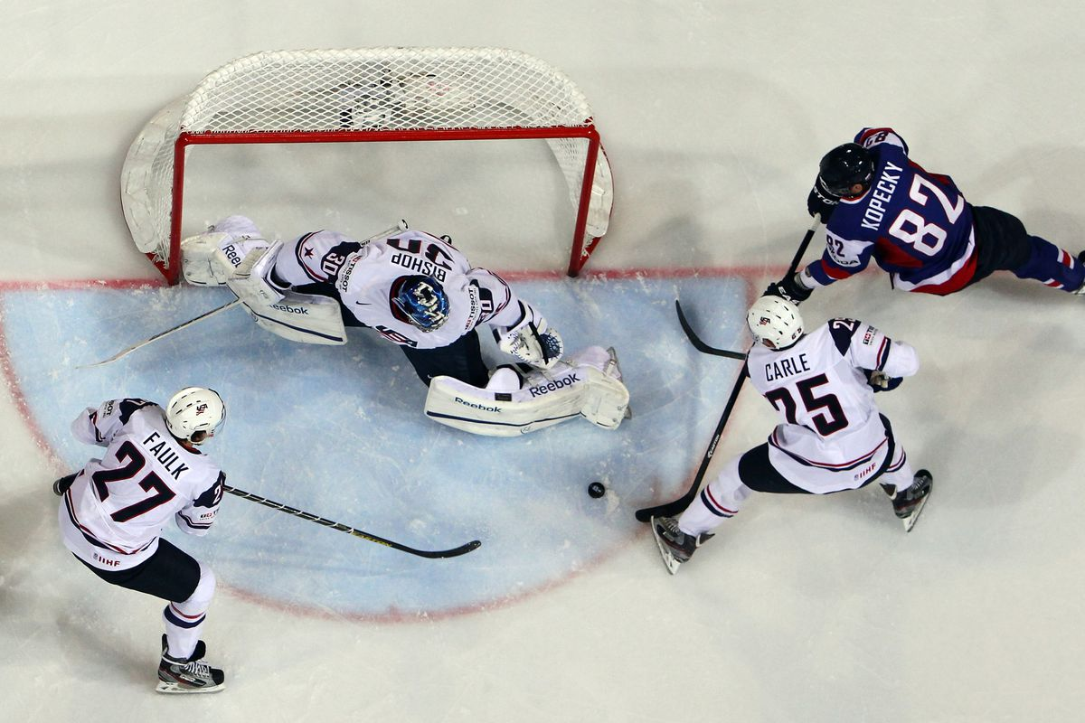 HELSINKI, FINLAND - MAY 14: Tomas Kopecky (#82) of Slovakia and Matt Carle (#25) of USA battle for the puck during a match between Slovakia and USA