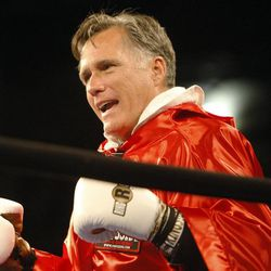 Former Massachusetts Gov. Mitt Romney prepares to fight during the Charity Vision Fight Night event in Salt Lake City, Friday, May 15, 2015.