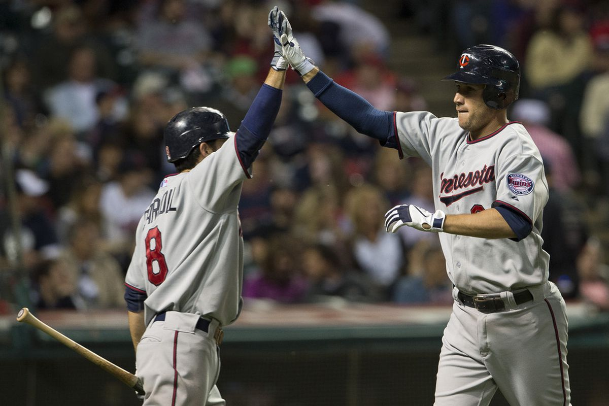 """Trevor Plouffe must be at least 5'6"""" based on this picture of him next to Jamey Carroll."""