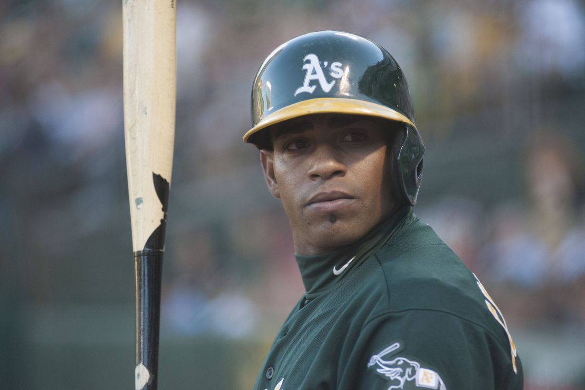"""Cespedes checks the sign from third base. Gallego gives him the signal for """"hit a homer."""""""